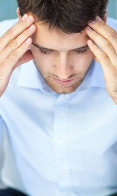 bigstock-Young-man-with-headache-53007634