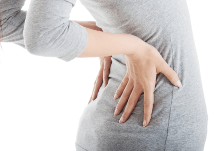 Young woman with back pain.